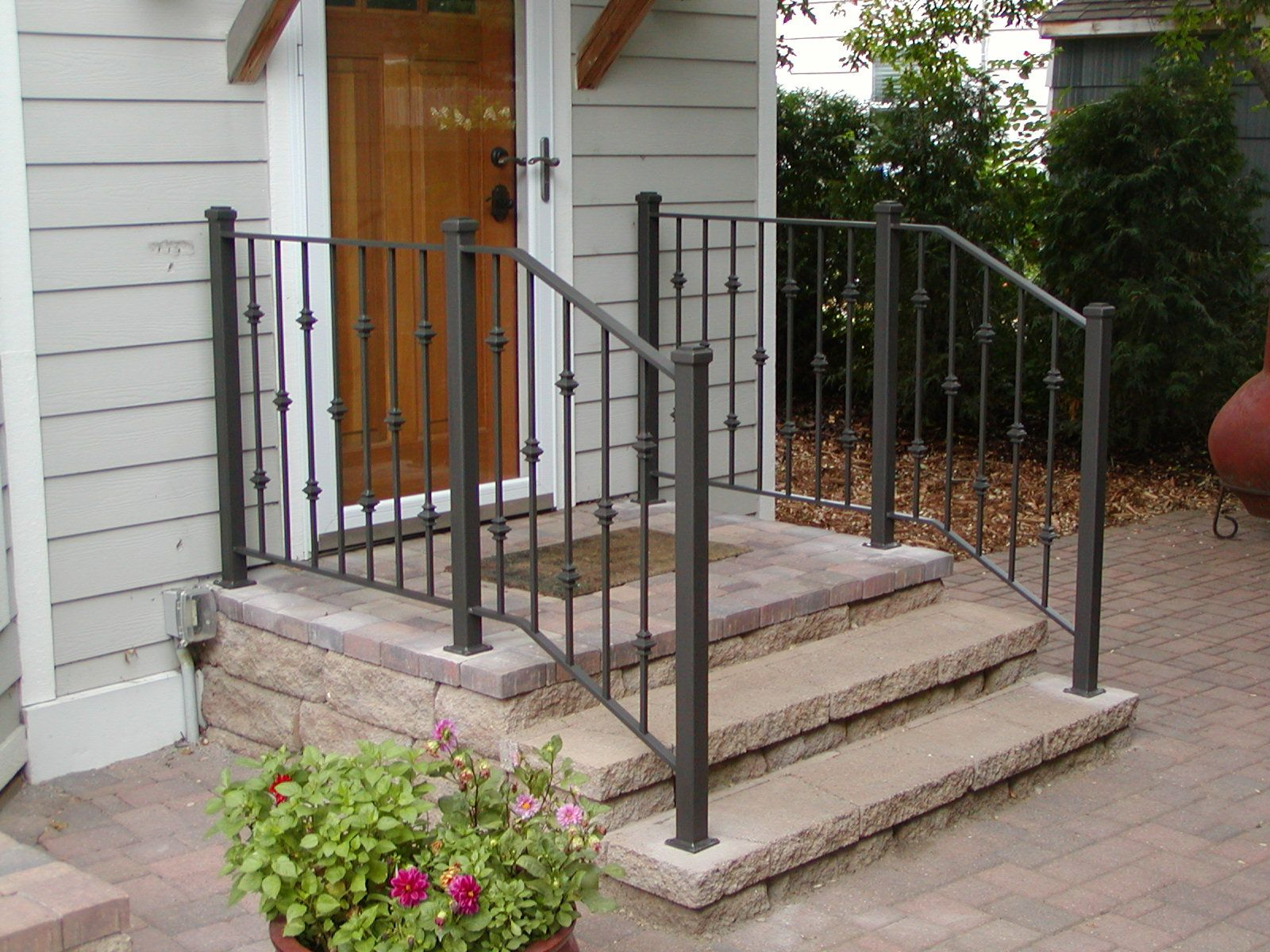 fun wrought iron staircase. Iron step railing with 2 inch square posts and cast collar pattern