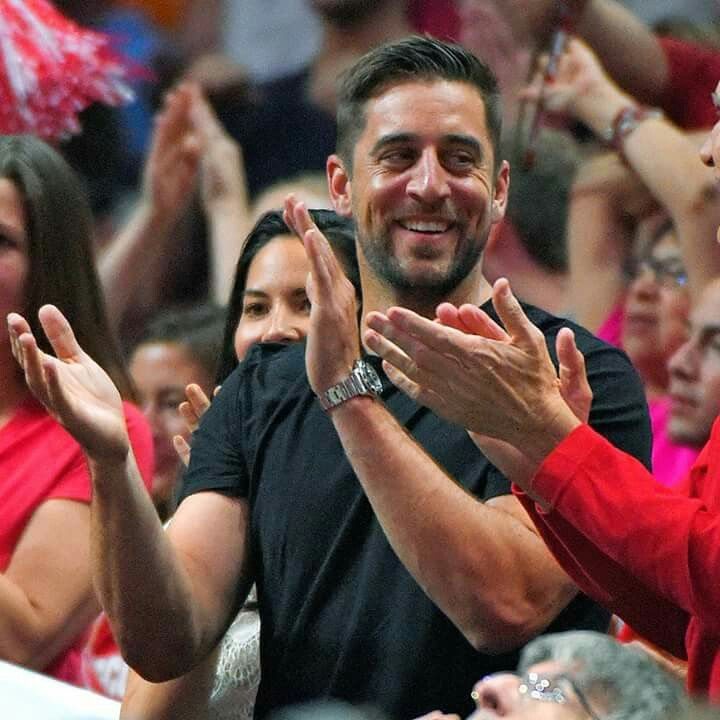 Aaron Rodgers watching the Wisconsin Badgers advance to the Final Four. If he cheers on the Badgers, I could cheer him on.