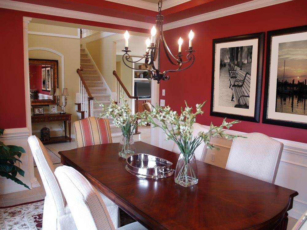 Formal dining room with white and red walls  dark wood table and white dining  chairs  love the chandelier and covered chairs This dining room features artwork on the walls  covering the bold  . Red Dining Chairs And Table. Home Design Ideas