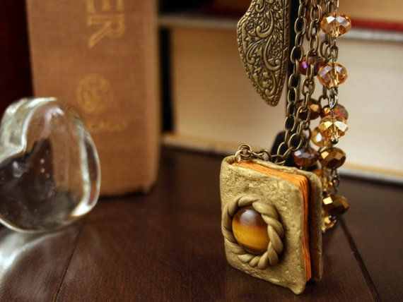 Gold And Copper : Eye of jupiter antique golden bookmark with gold and copper