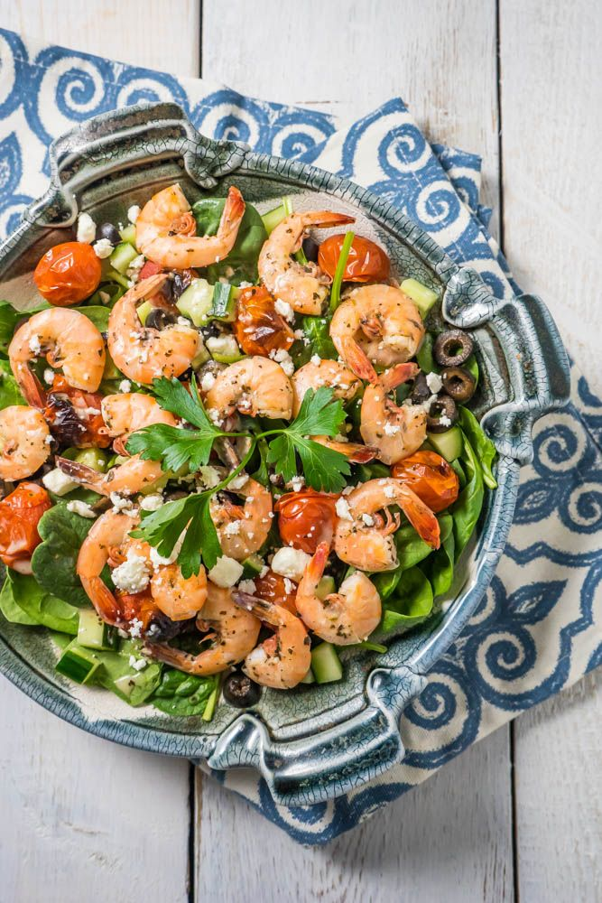 Greek Shrimp Salad with fresh baby spinach, cucumber, black olives, roasted cherry tomatoes, feta cheese, shrimp and a delicious warm dressing!