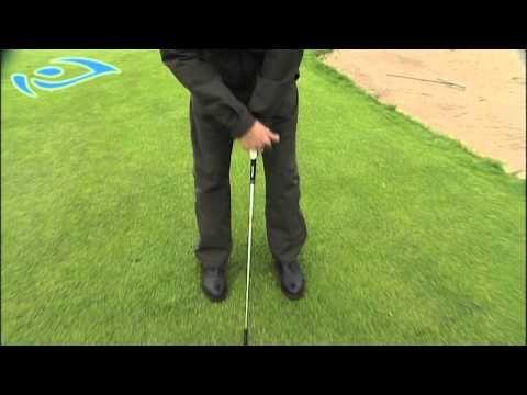 Elixir - Golf -  Lähipeli - Korkea chippi bunkkerin yli. Golf pro Mikael Piltz shows high chip with a 54 degree wedge.