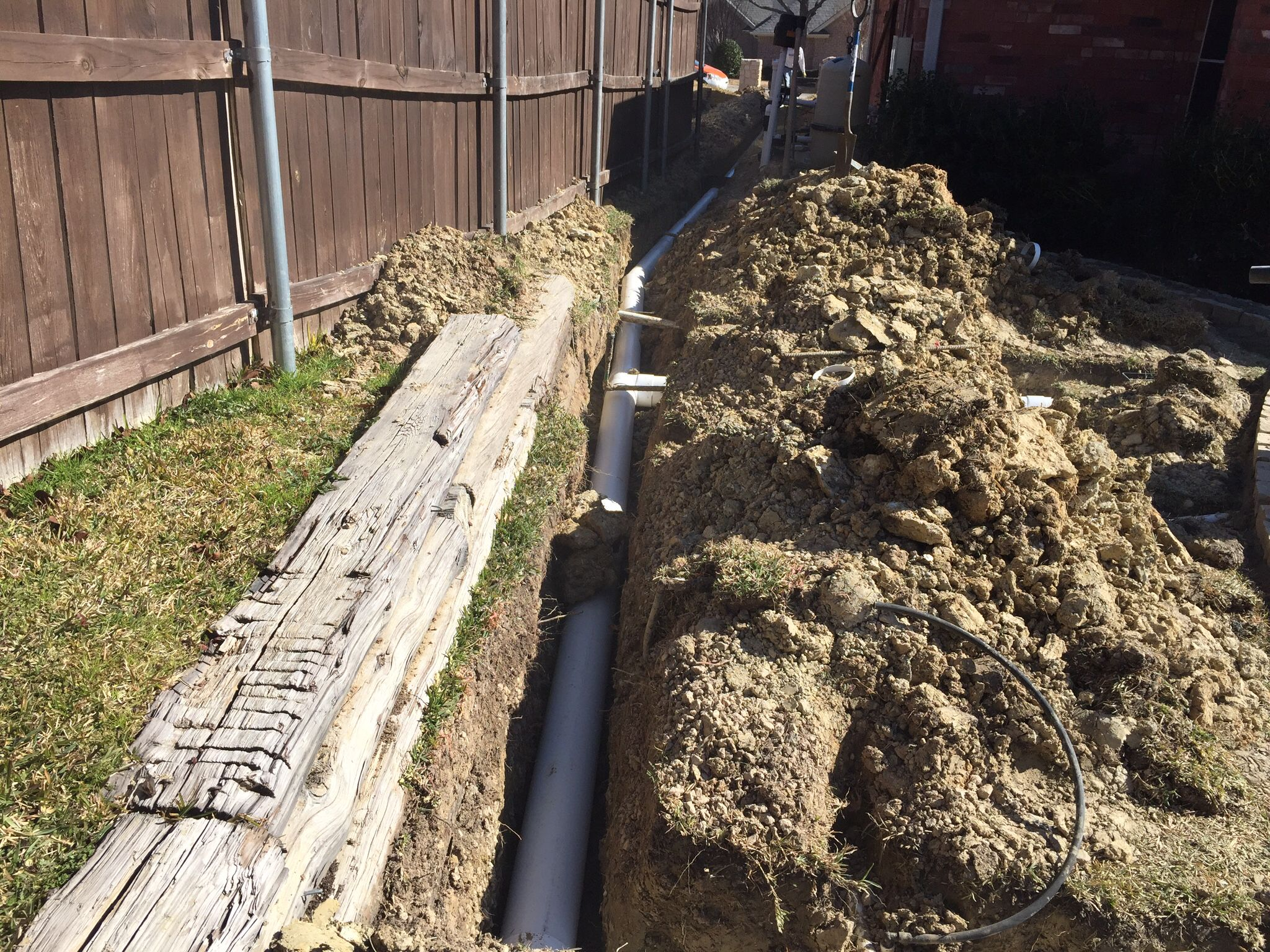 Drainage system installed for a back yard using 6 inch pvc for Garden drainage system