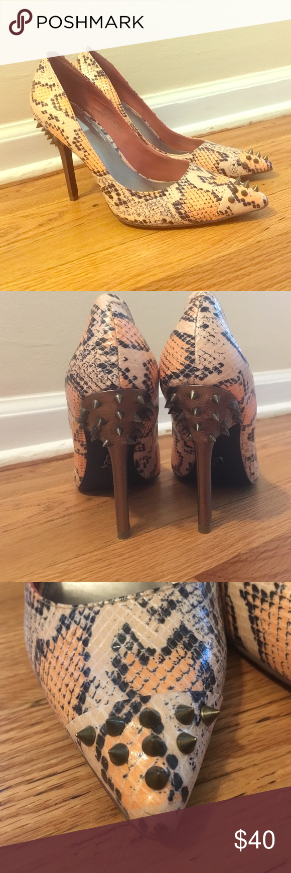 New faux snake skin heels Super sexy heels! The faux snake skin as well as spiked detail are perfect for adding edge to any outfit. These are multi colored orange, tan, and a black/grey combo (see pics because it's hard to describe). These have been worn once. I love these shoes and want them to be put to use. I just don't get out much anymore! Rachel Roy Shoes Heels