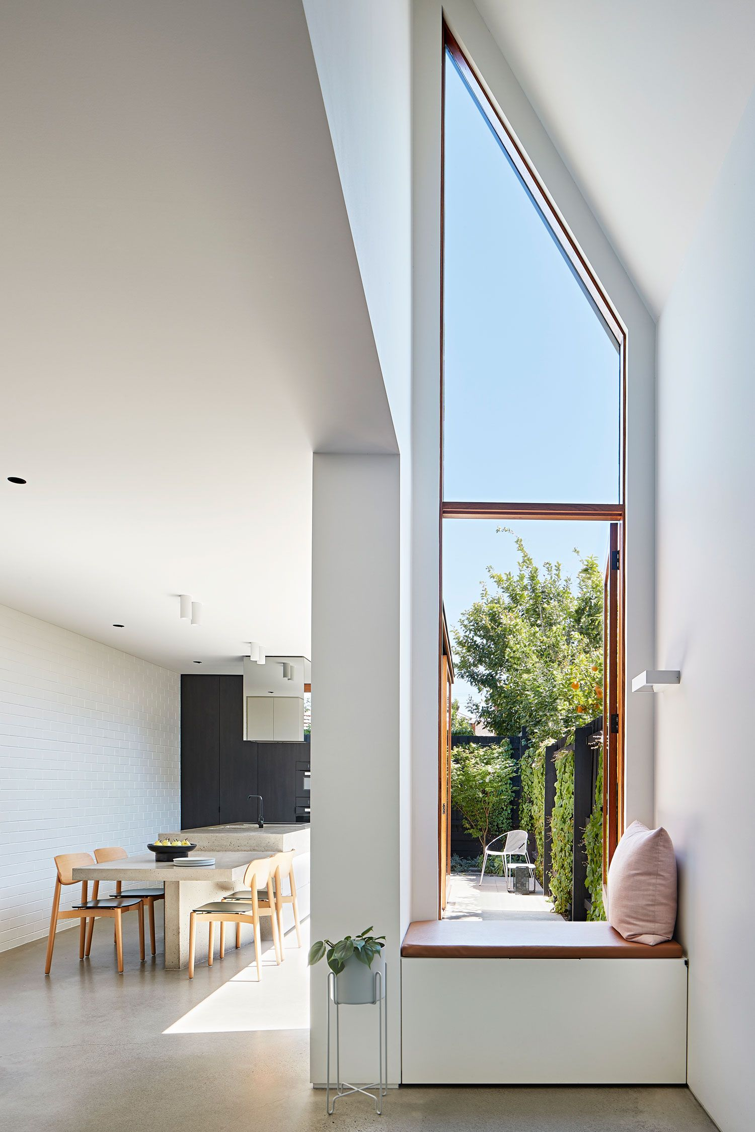 Injecting a new sense and purpose into a modest workers' cottage in Abbotsford, Melbourne, considered internal voids are created by Lande Architects to encourage a flood of natural light into the narrow terrace.