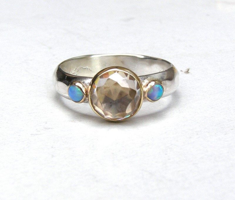 Engagement Ring Similar diamond wedding ring -whiteTopaz  and tiny Blue Opals ring -MADE TO ORDER by OritNaar on Etsy https://www.etsy.com/listing/118618961/engagement-ring-similar-diamond-wedding
