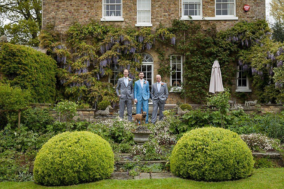 Groom, father and usher stand in the landscaped garden at Preston Court - a Kent wedding venue - © Fiona Kelly wedding photography