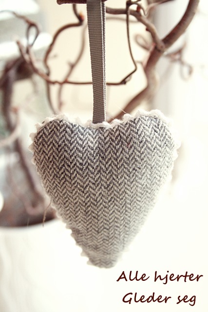 ♥... Ornament from old pants? embroider yea on them, red rick-rack to offset tweed?