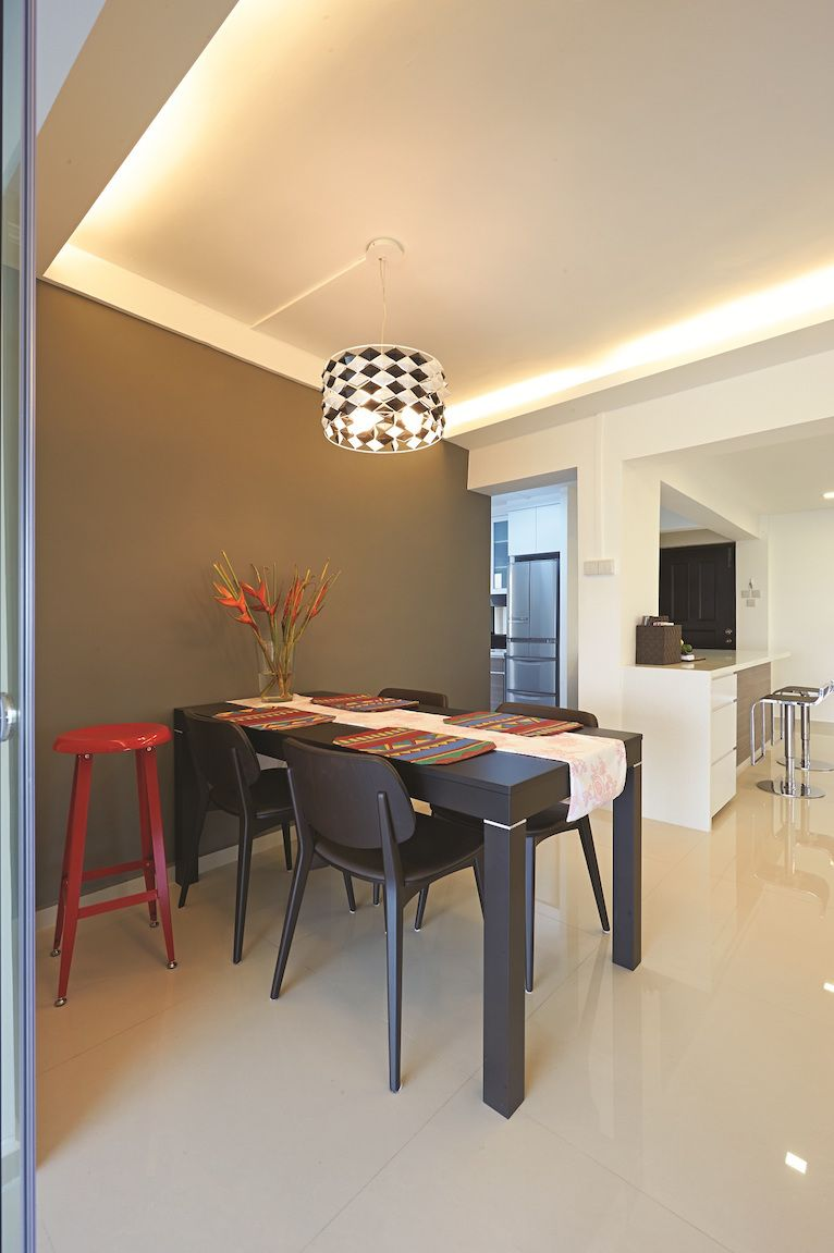 This HDB flat has all the elements of a modern Western apartment. From the color scheme down to the subtle warmth of the furnishings and the bar type kitchen. Another characteristic of a modern Western apartment is the wide space for anyone to freely move around in. The living room is a testament to the …