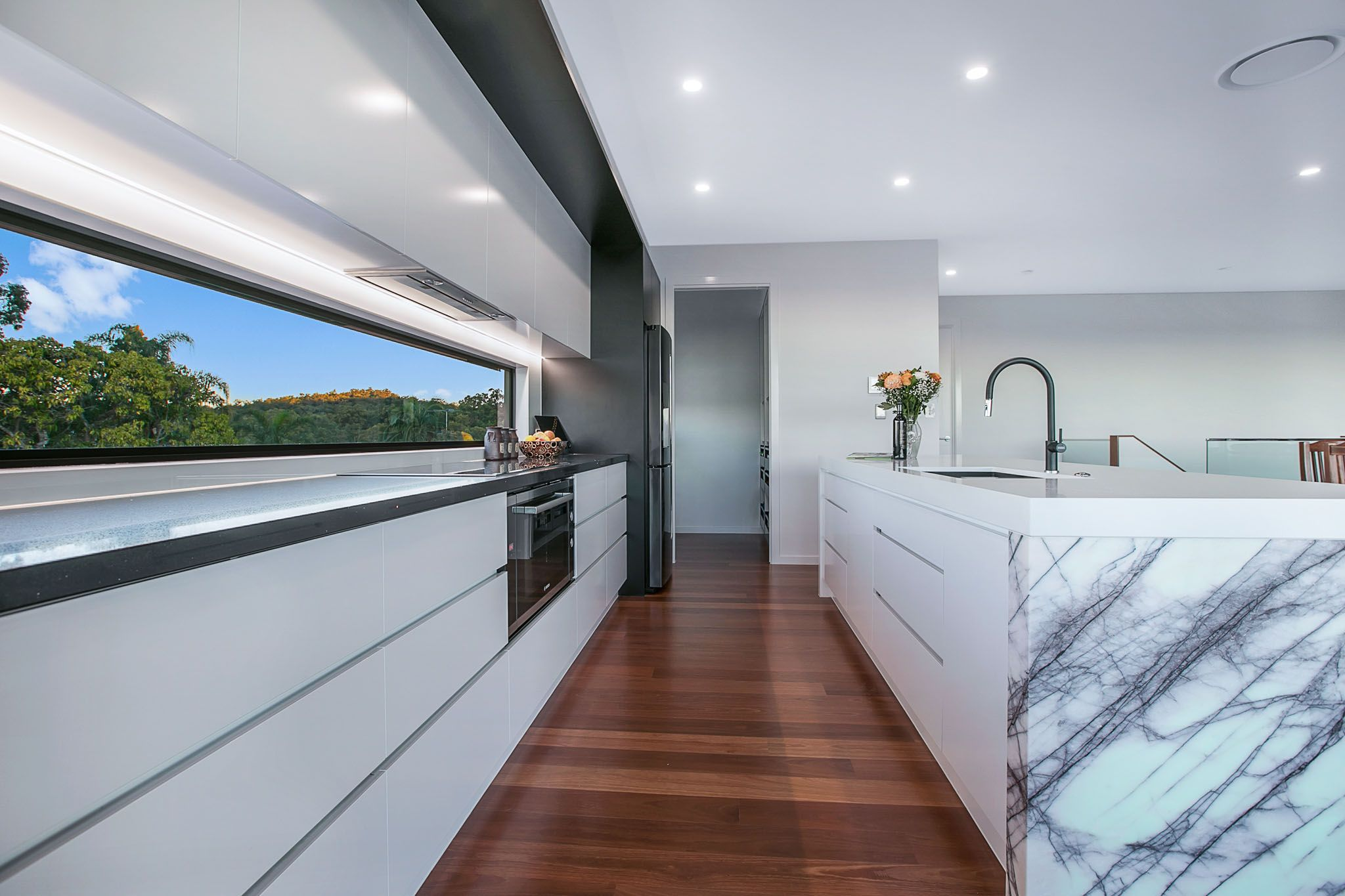 Urban Kitchens and Joinery White kitchen with marble and