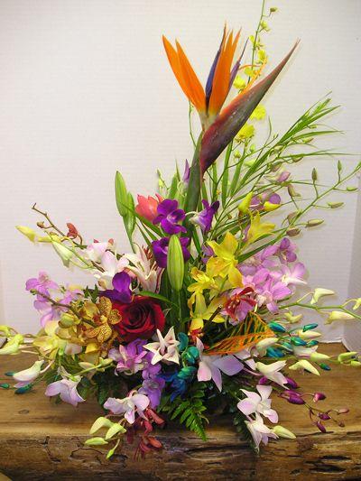 Beautiful floral arrangements beach wedding