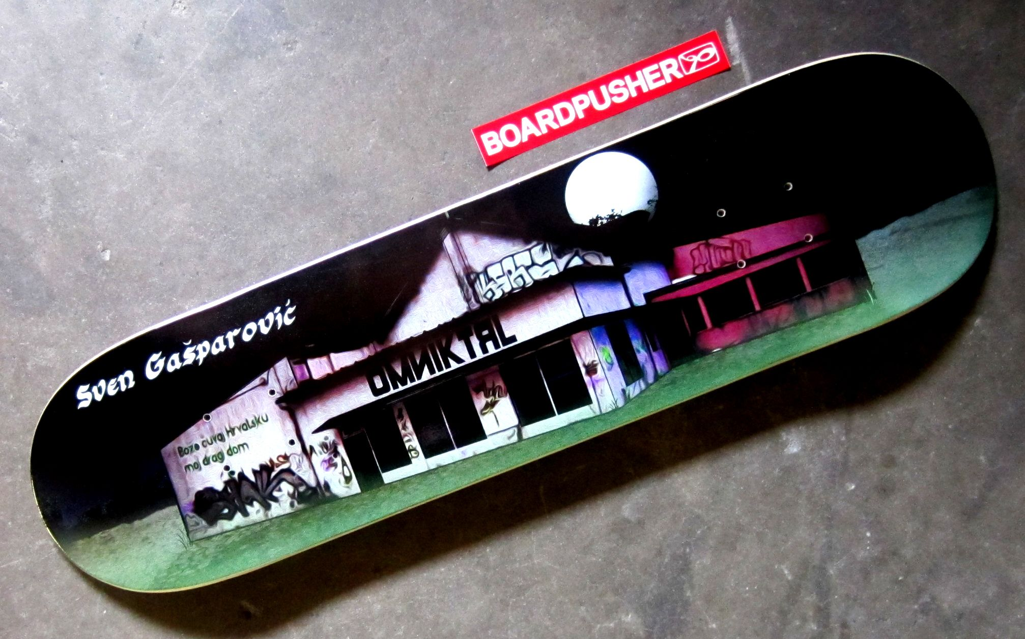 Setting for a creepy eastern European horror flick? No, today's Featured Deck is another sponsored Omniktrl rider. Sven Gasparovic's model depicts an abandoned warehouse in Zagreb that he and a few other Croatian skaters turned into a skatepark. Way to be resourceful, guys. You can pick this or some other Omniktrl decks up at www.BoardPusher.com/shop/OMNIKTRL.