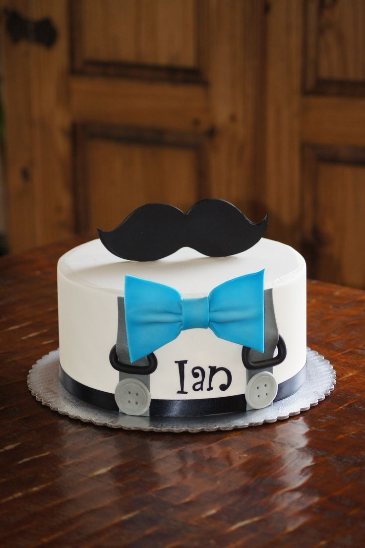 Suspenders and blue bow tie baby shower cake with mustache topper