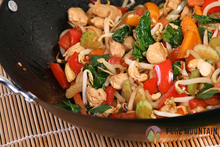 Charlie's Chicken Stir Fry | Pure Mountain Olive Oil and Vinegars | www.PureMountainOliveOil.com | This delicious stir-fry is loaded with delicious veggies; bell peppers, onions, mushrooms, broccoli, and more! Made amazing with Pure Mountain's Garlic Olive Oil and Traditional Dark Balsamic Vinegar.. your family will be begging for seconds! | #extravirginoliveoil #balsamicvinegar #garlicoliveoil #stirfryrecipe #stirfry #asianrecipe