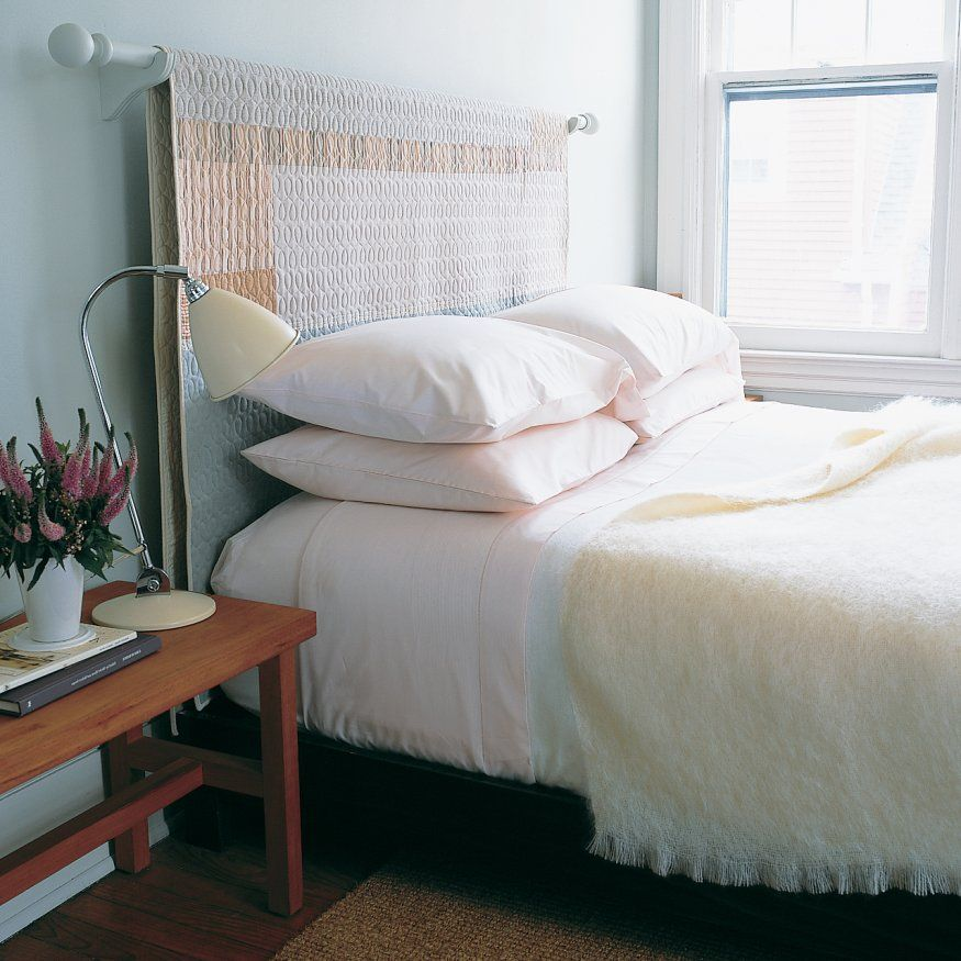 Here's a way to display a favorite quilt and provide your bed with a new headboard.