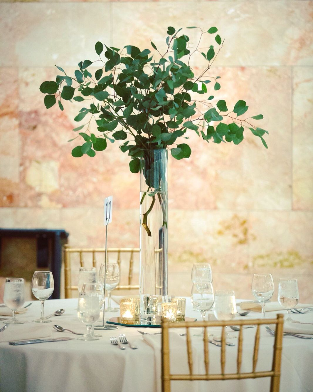Tall silver dollar eucalyptus centerpieces from the