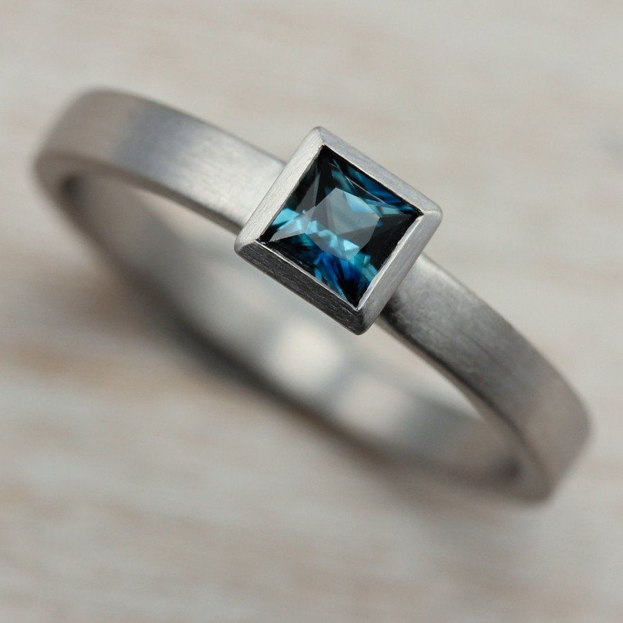Our Square Solitaire Engagement Ring with Denim Blue Australian Sapphire, set in 950 Palladium.