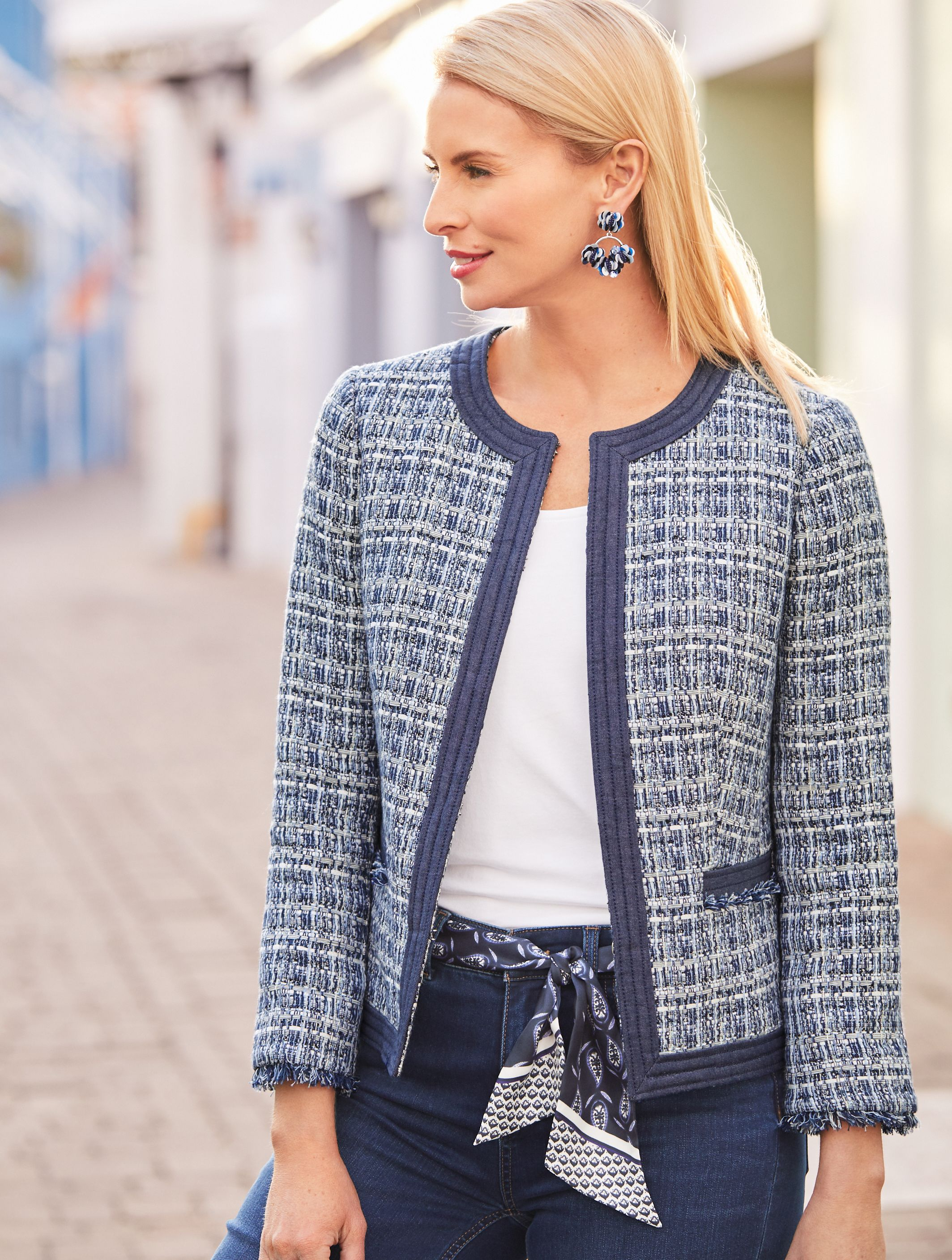 c687f367d0 Sophisticated yet versatile, our reimagined tweed jacket is stunning with  updated chambray trim and delicately fringed details at the cuffs and  pockets.