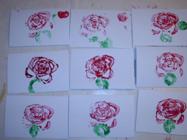 celery roses.  For some I tried to do thumbprint hearts and one we outlined it with red glitter.  It turned out beautifully.  You just chop the bottom of a celery off, dip it in red paint and use a celery stalk for leaves.  Super simple and my 3 year old love doing it. And the teachers and the close family loved receiving them.