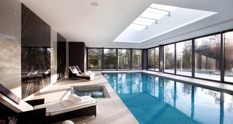Luxury indoor swimming pool design installation company for Indoor pool designs