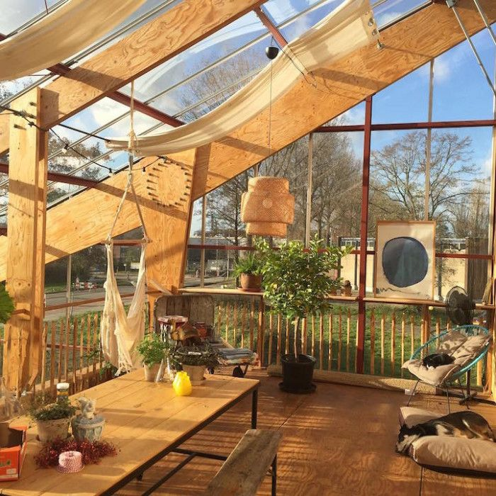 An ecofriendly family that lives in a giant greenhouse