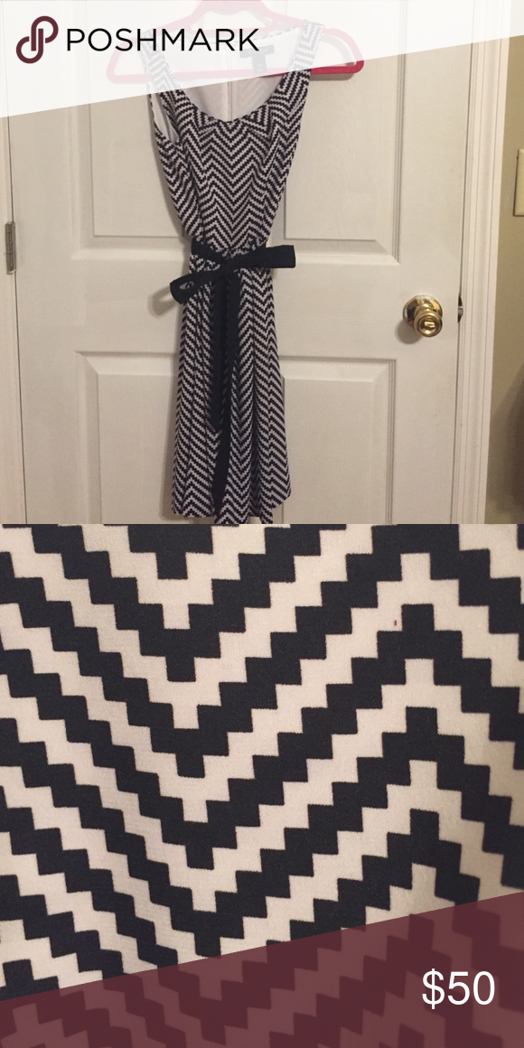 Black and white dress with tie White House Black Market dress. Never worn just took the tags off. Chevron/zig zag pattern. Great condition! White House Black Market Dresses