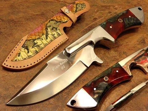 Bushcraft Hunting knife Made by :Ozair custom | D2 Tool Steel Mirror polish Full tang knife Overall Knife Length : 10 INCHES Blade Thickness: 5.24 MM Handle: Stabilized buckeye burl exotic wood with Mosaic pin Bolster: D2 Tool steel Knife Weight: 0.451kg Sheath: Leather with skin inlay. Price: $200