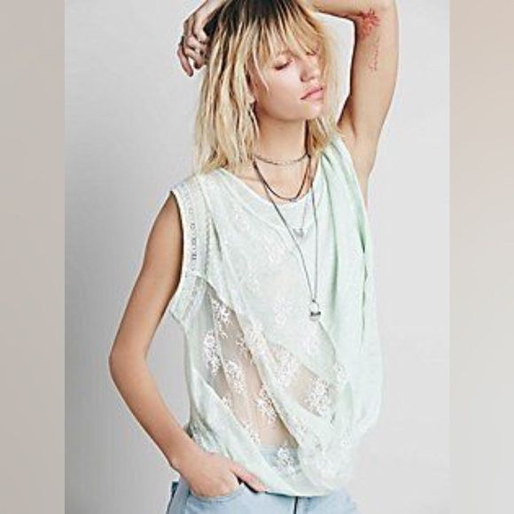 Free People New Romantics twist and shout top New top by New Romantics, I've worn it maybe three times. It's breezy and stylish and comfortable. Color is mint. Size medium Free People Tops Blouses