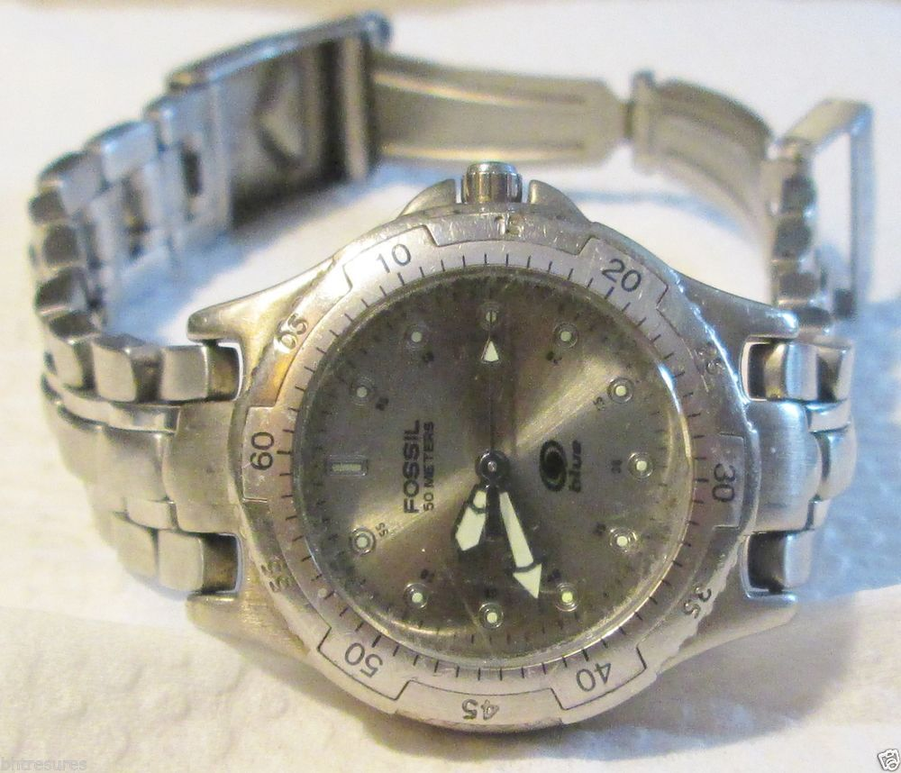 WOMAN'S FOSSIL BLUE GLOW IN DARK FACE STAINLESS STEEL