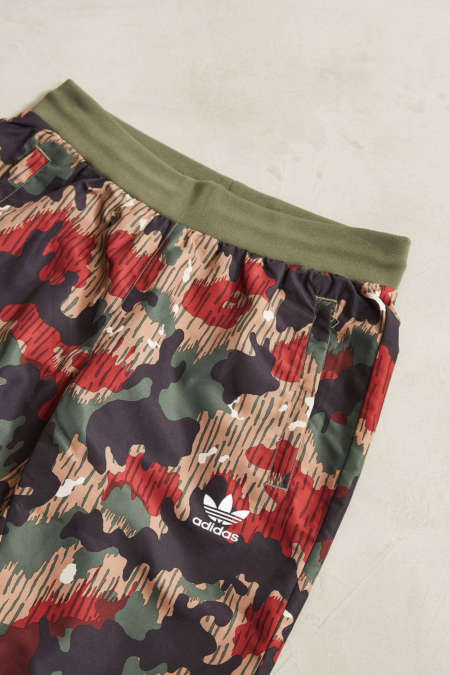 a41cca26e Shop adidas X Pharrell Williams Hu Hiking Camo Wind Pant at Urban  Outfitters today. We carry all the latest styles