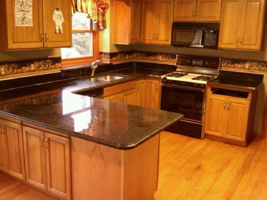 Honey Oak Kitchen Cabinets With Black Countertops | Granite Kitchen Countertops  Michigan   One Low Square