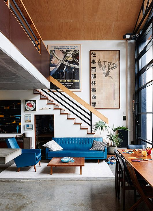 Light Filled Contemporary Living Rooms: Peacock Blue Sofa And Chair. Natural Wood And Unusual Wall