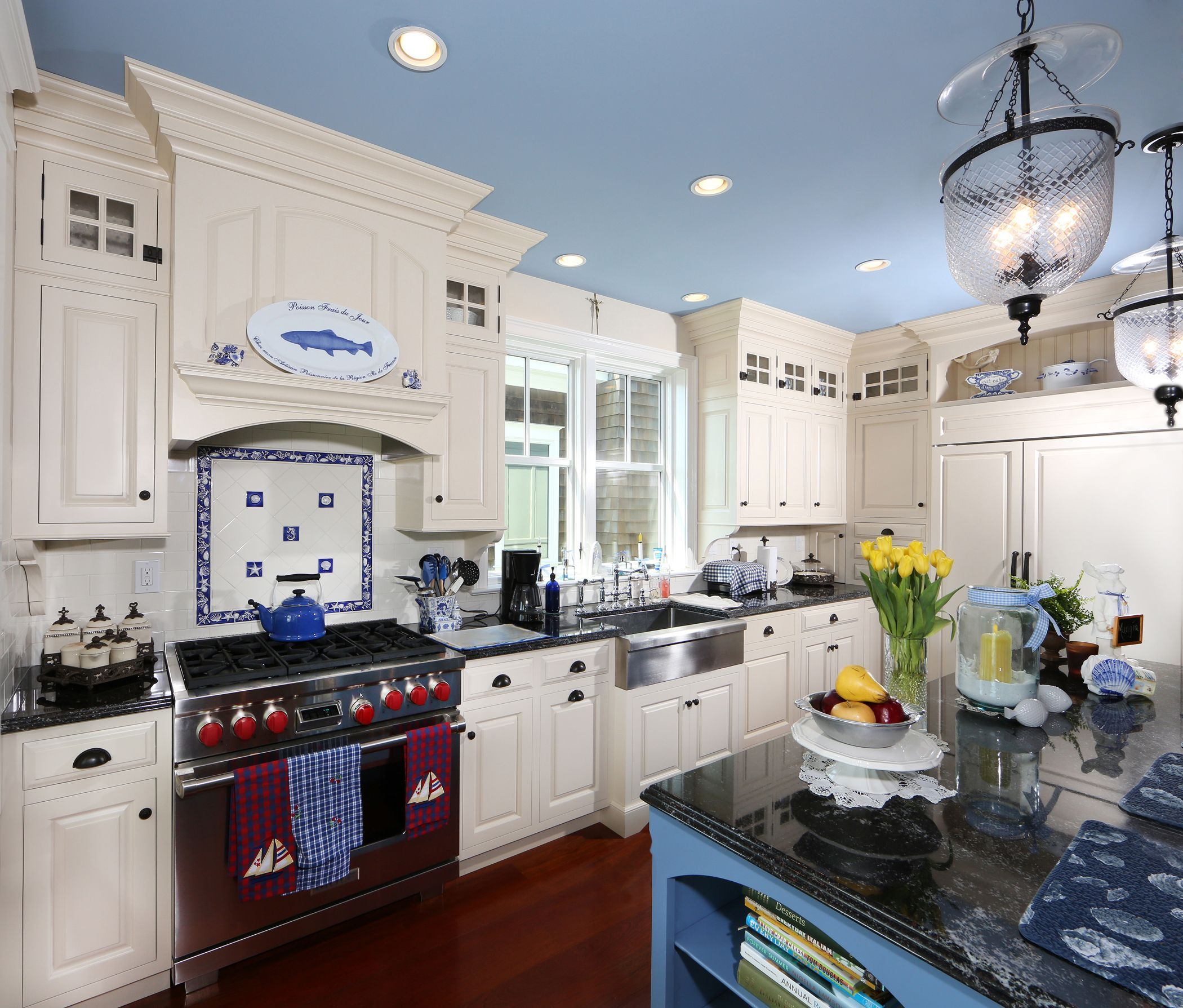 Custom Kitchen featuring white painted cabinetry, with custom blue ...