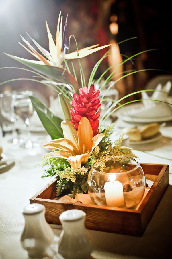 Tropical wedding photo with beach inspired centerpiece for