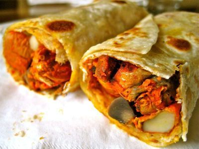 Barbecued chicken rolled in egg paratha