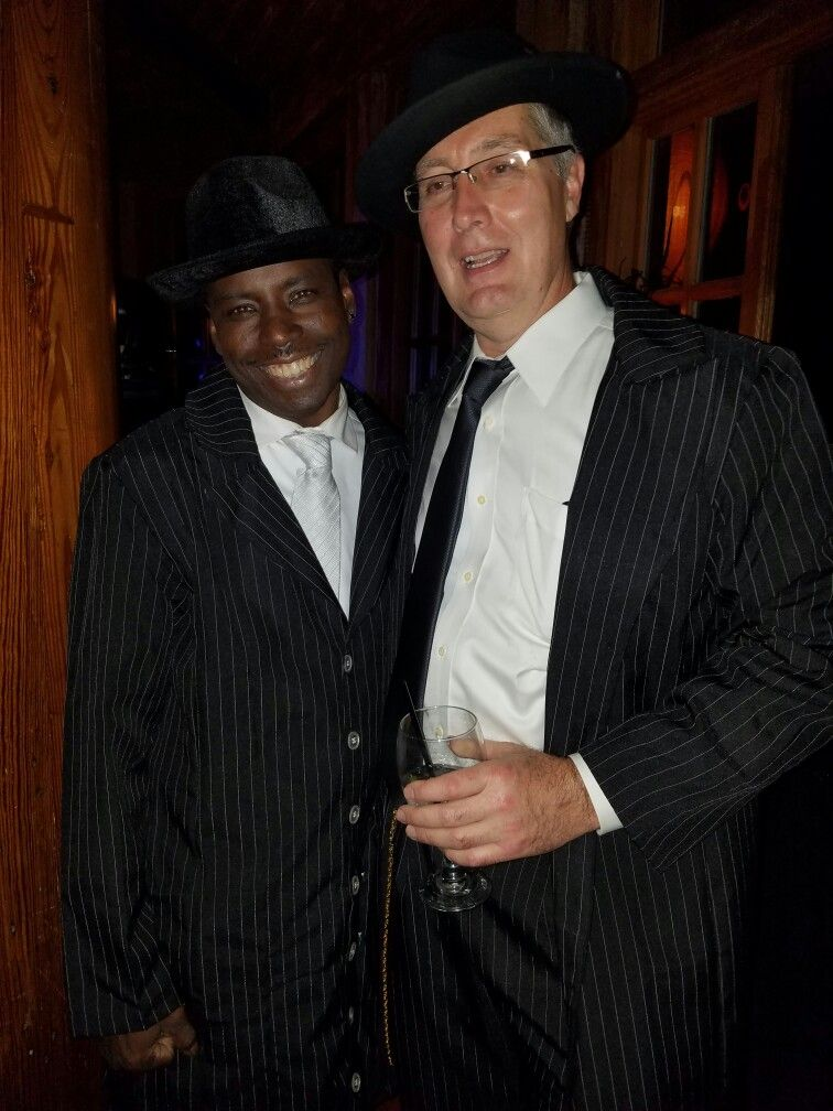 Two guys in zoot suits, with fedoras and suspenders Zoot