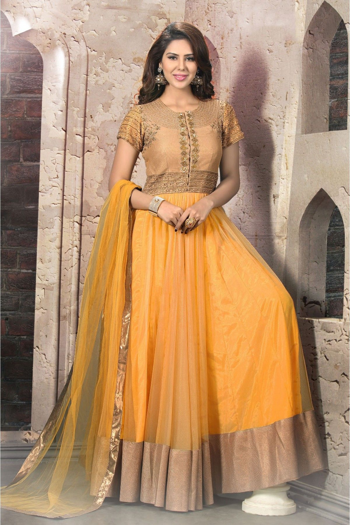 Net and silk semi stitched anarkali suit in yellow gold colour