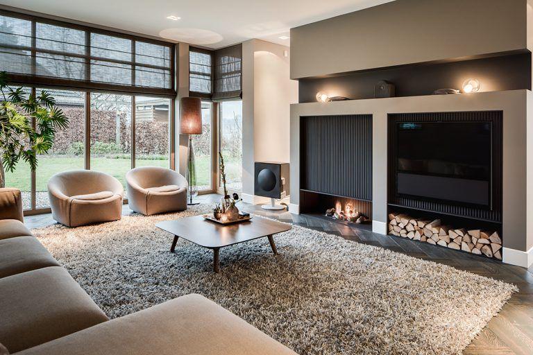great woonkamer inrichting met luxe open haard with