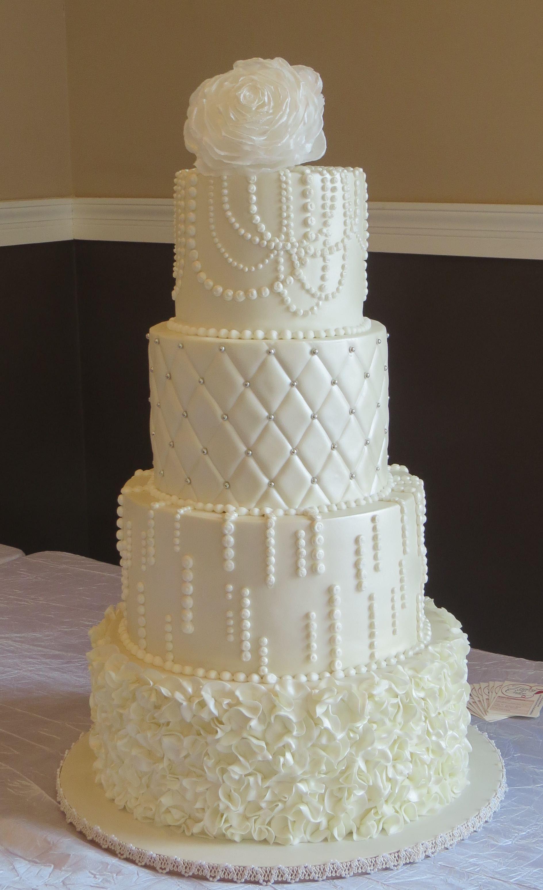 White Wedding Cake Decorated With Fondant Ruffles Royal Icing