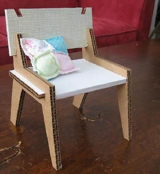 Cut dolls house chair made out of cardboard.