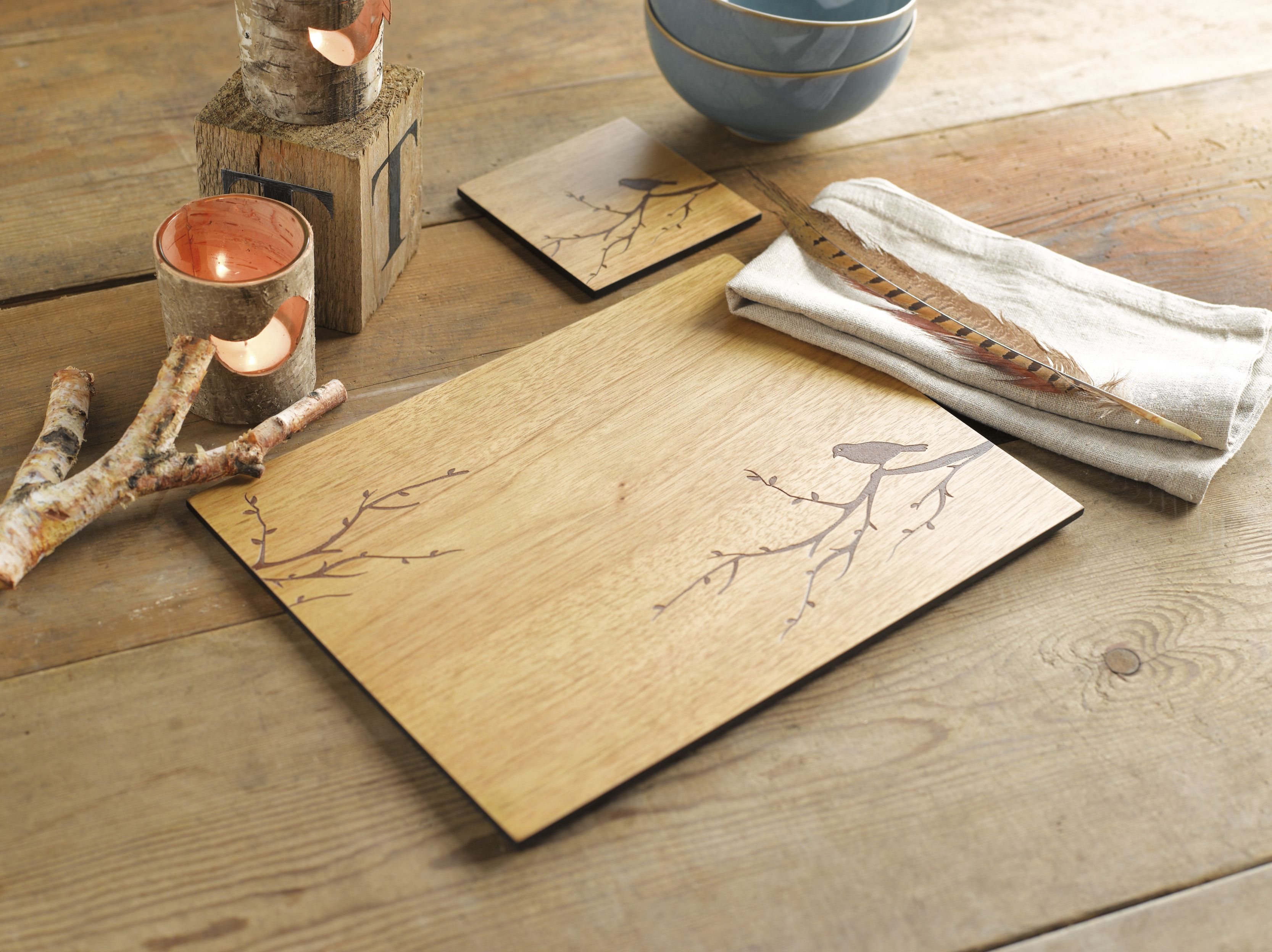 These etched wood bird placemats from Denby certainly bring a natural organic feel to the tabletop. They are made from durable wood veneer with a wipeable surface. www.denby.co.uk #tableware #placemats #denby