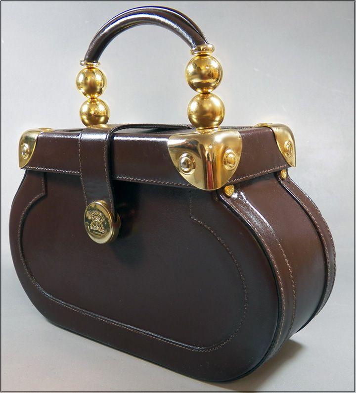 34f2fa74e241 Retro chic! Train case styling on this handbag by Gabbrielli ...