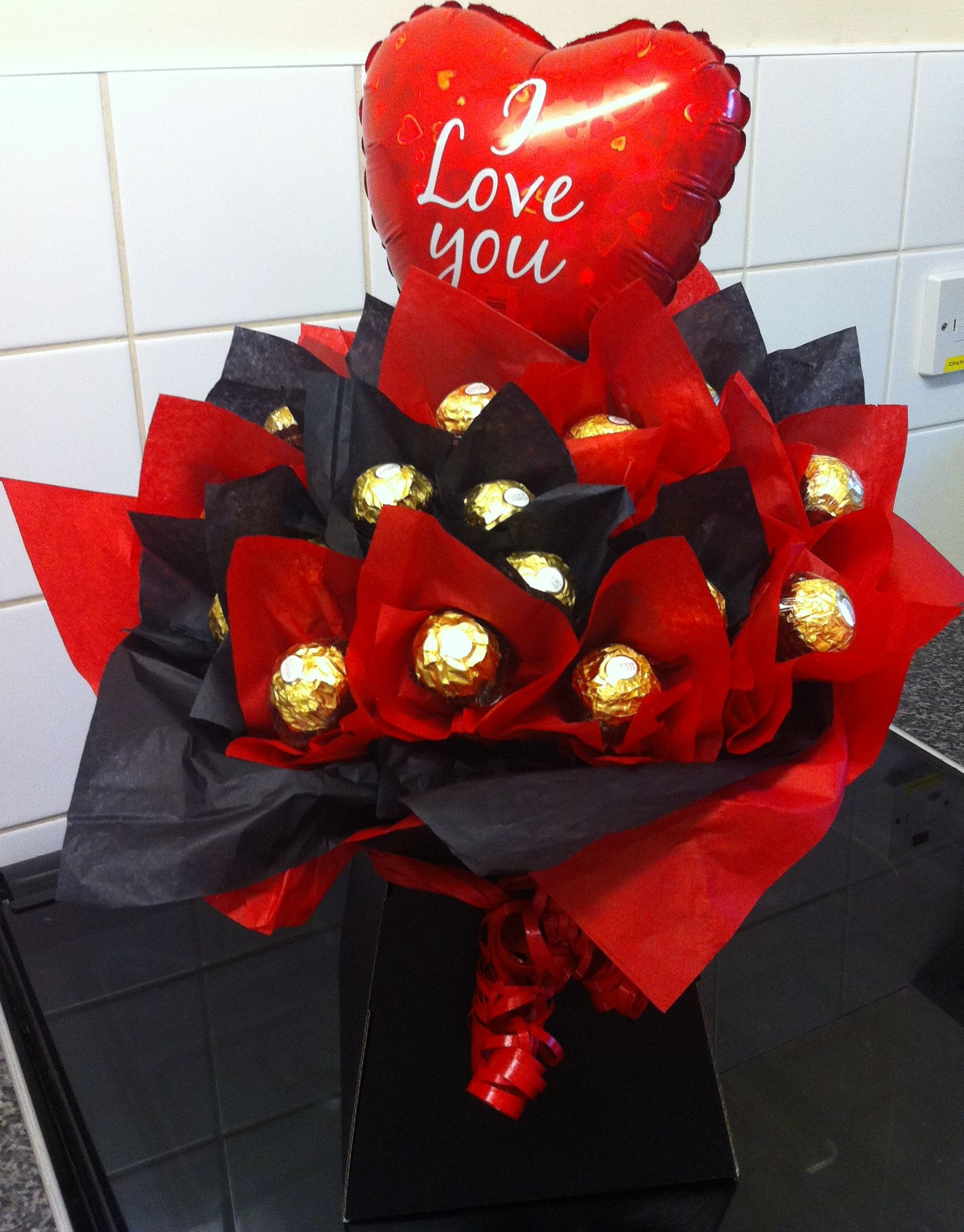 Valentines Bouquet - 2 dozen Ferrero Rocher displayed in a Black Box and in the colours of Black and Red - also with an 'I Love You' balloon