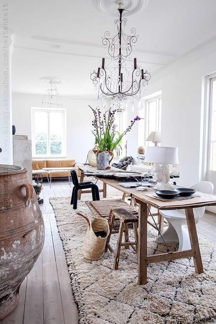 A Large Rug Placed Under This Dining Table Helps Anchor The Room Neutral Moroccan And Long Natural Wood Make Appear Even Larger