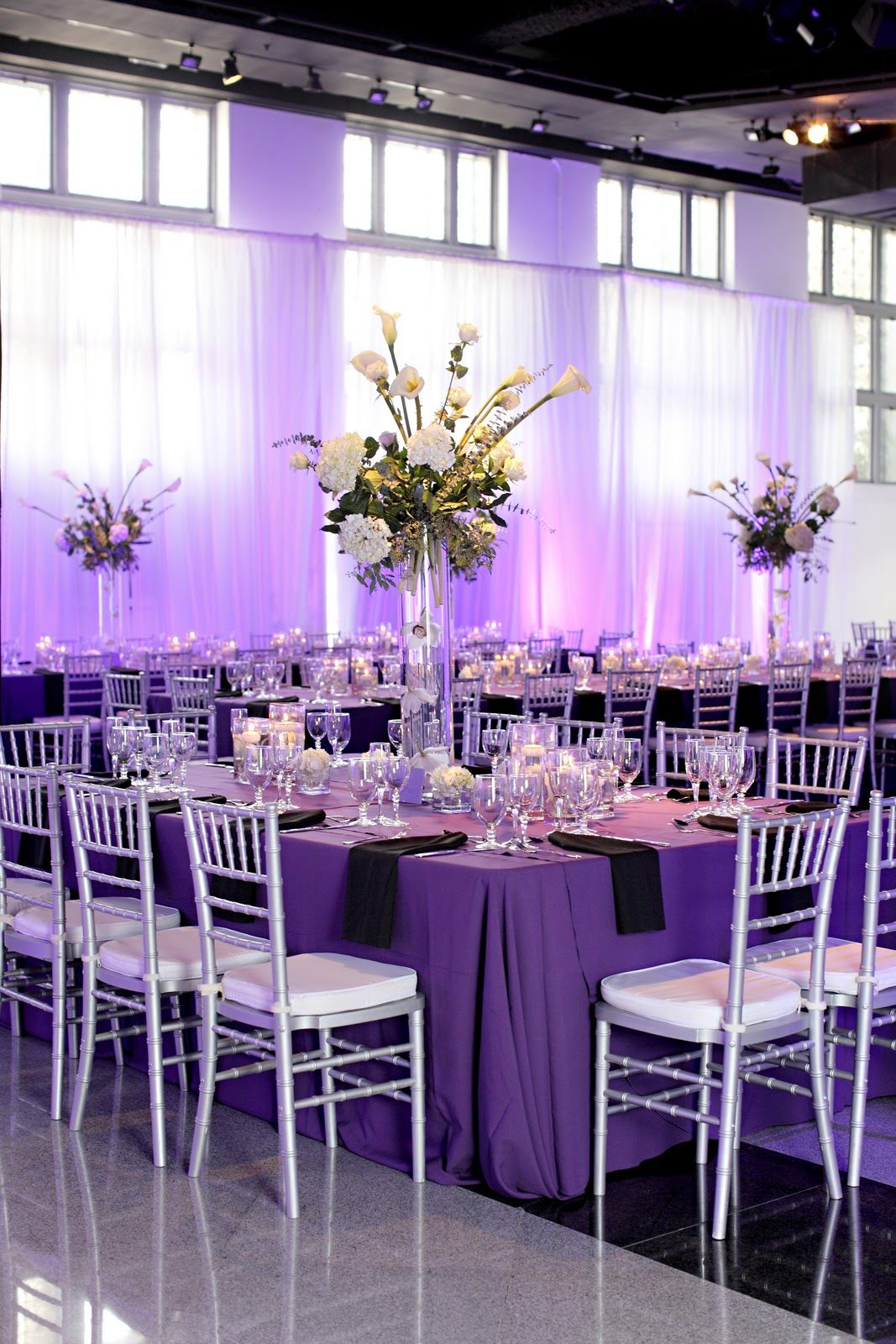 Beautiful rectangle tables purple tablecloths silver chivalri rectangle tables purple tablecloths silver chivalri chairs with white cushions black napkins clear cylinder vases and white floral arrangements with junglespirit Image collections