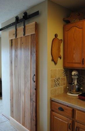 Diy Rustic Pantry Door On Rollers Give Dark Wood Tones
