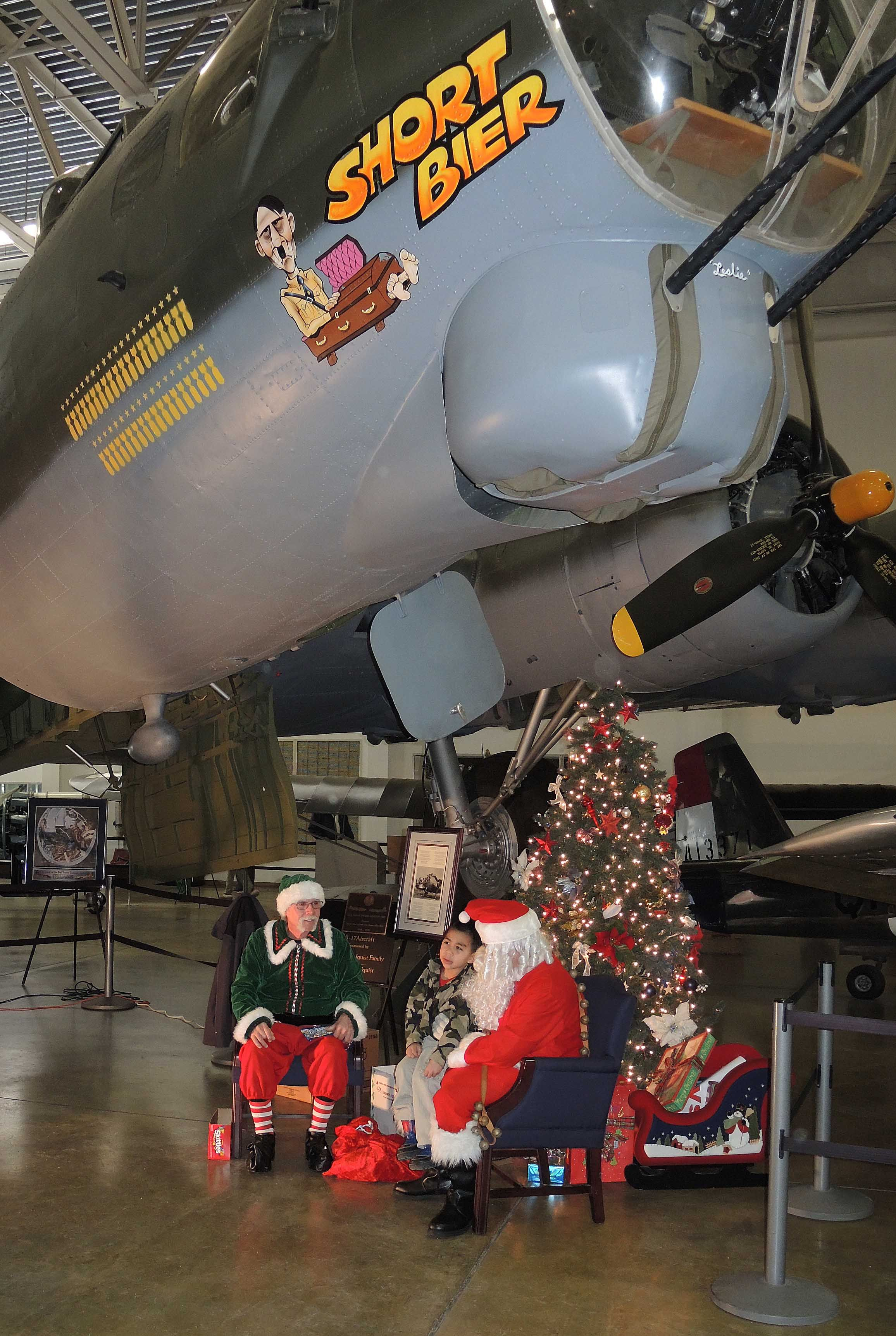 Santa Claus with kids at Hill Aerospace Museum. Just of I