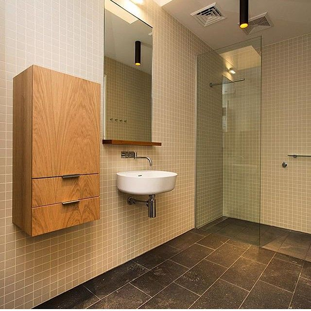 White wall mounted round basin, chrome tap and mixer, chrome piping ...