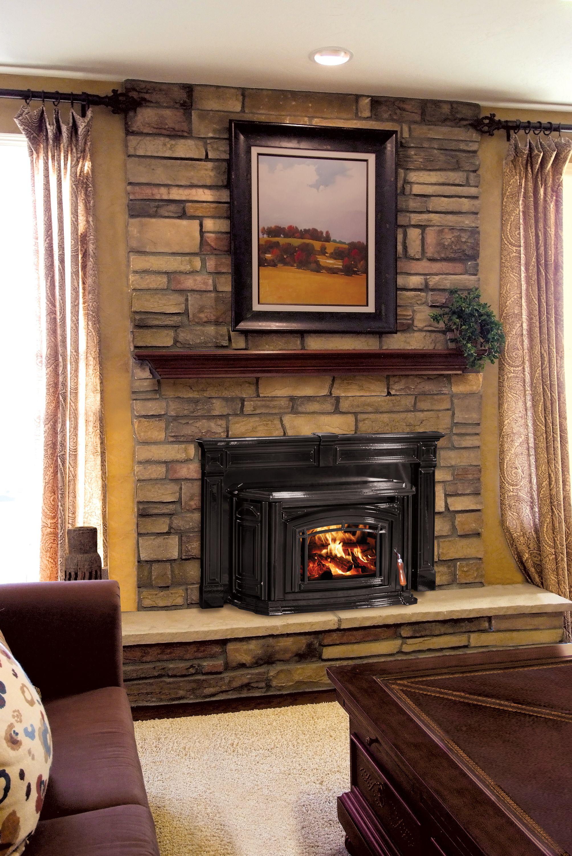 Beautiful fireplace insert with custom surround we love