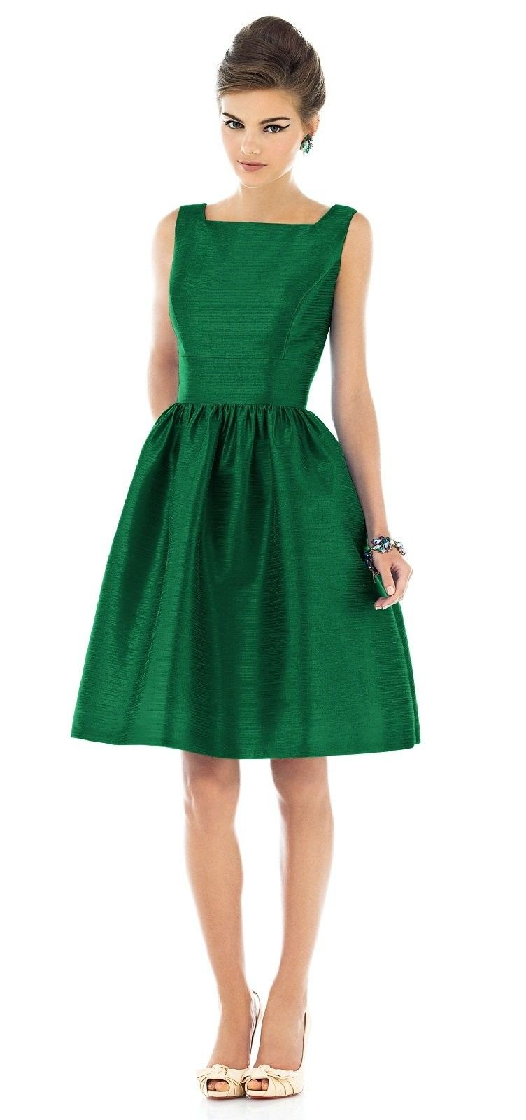 Retro Emerald Dress perfect for a mad men themed wedding.\